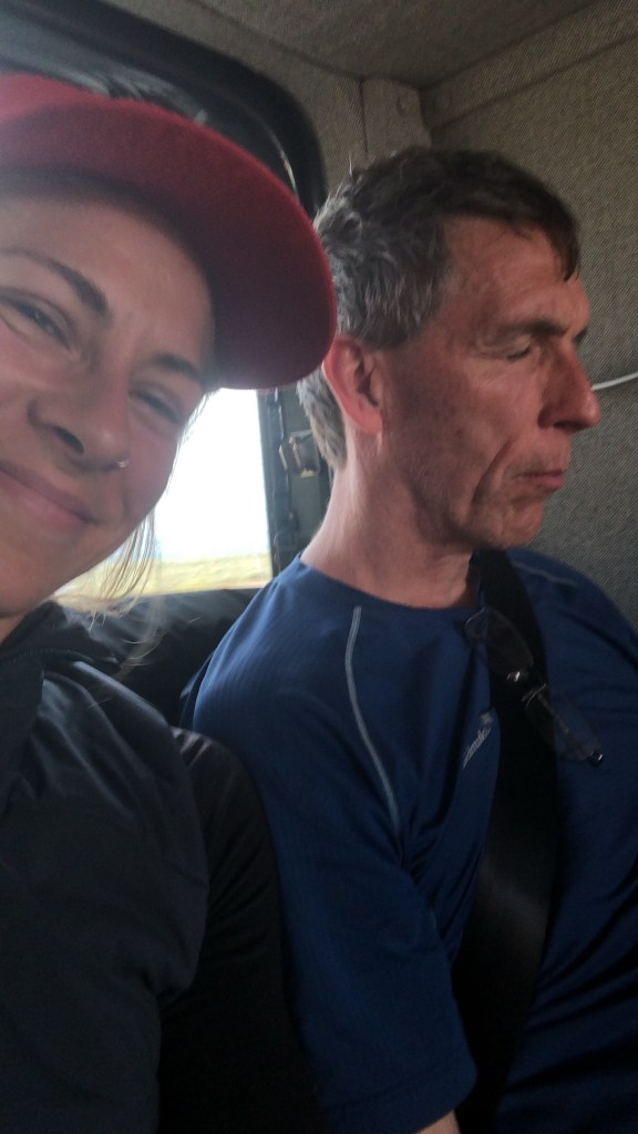 Emily and sleeping Chuck in the van