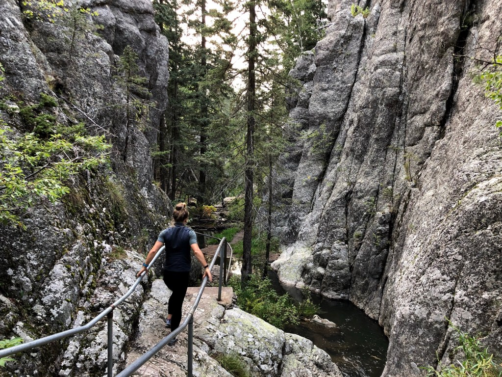 Emily hiking down rails at Custer State Park through the rocks
