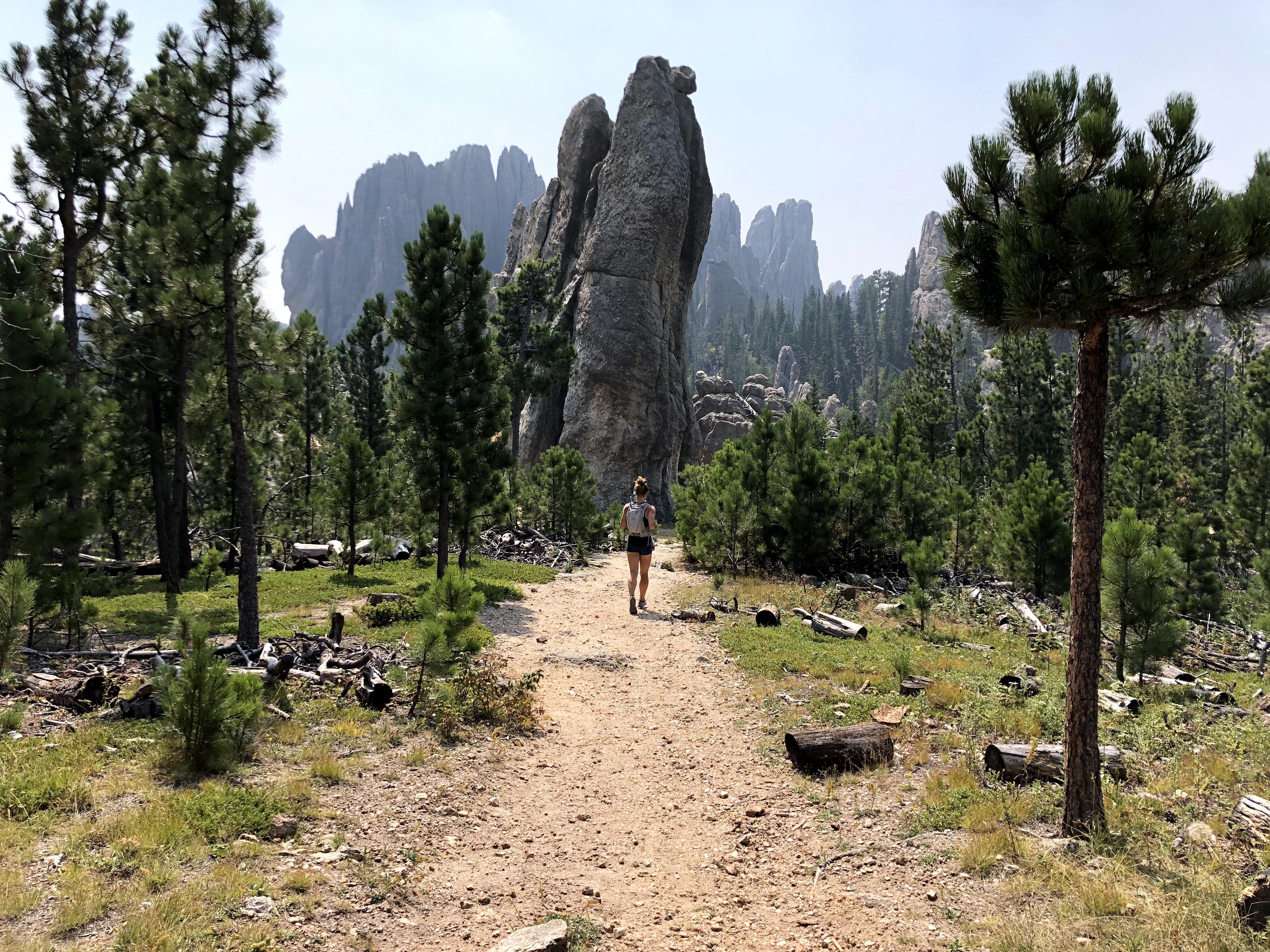 Emily running towards Cathedral Spires in Custer State Park