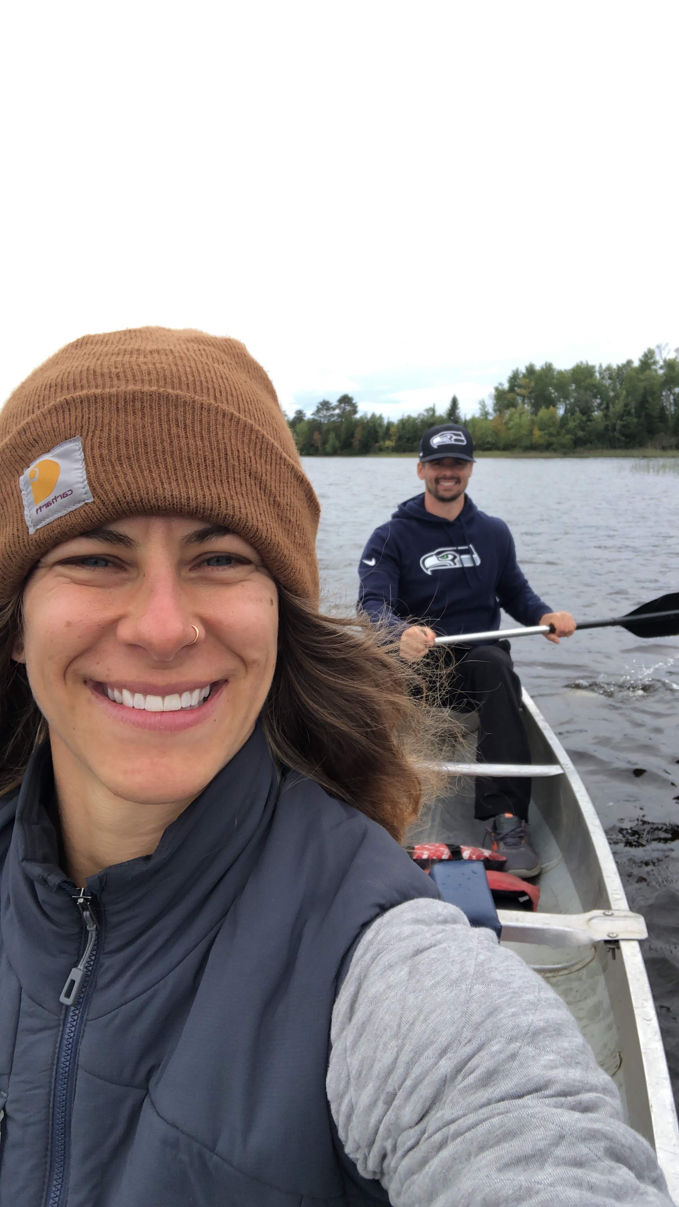 Emily and Joe canoeing On the Boundary Waters of Fall Lake