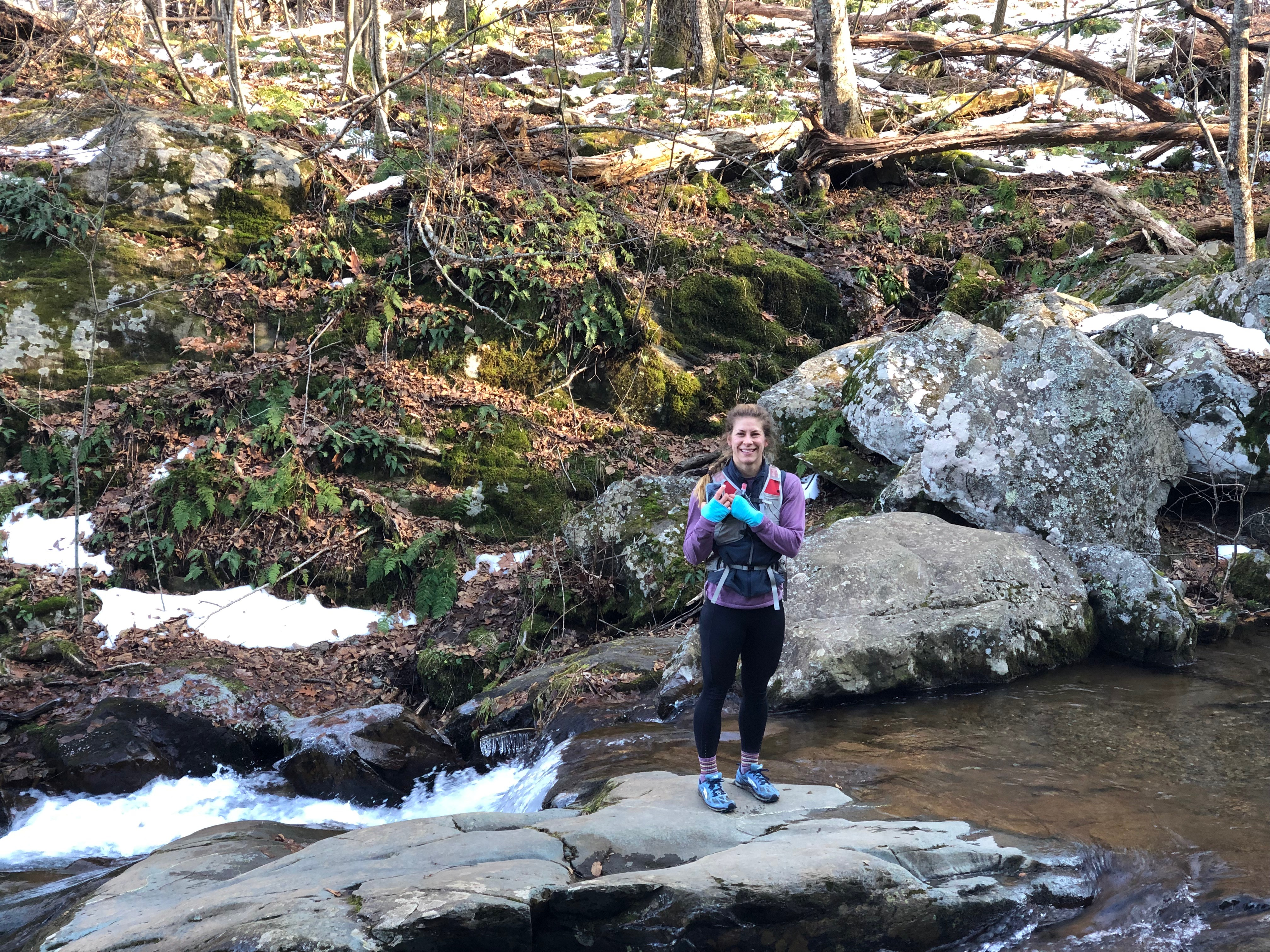 Emily during trail run in Shenandoah National Park next to river