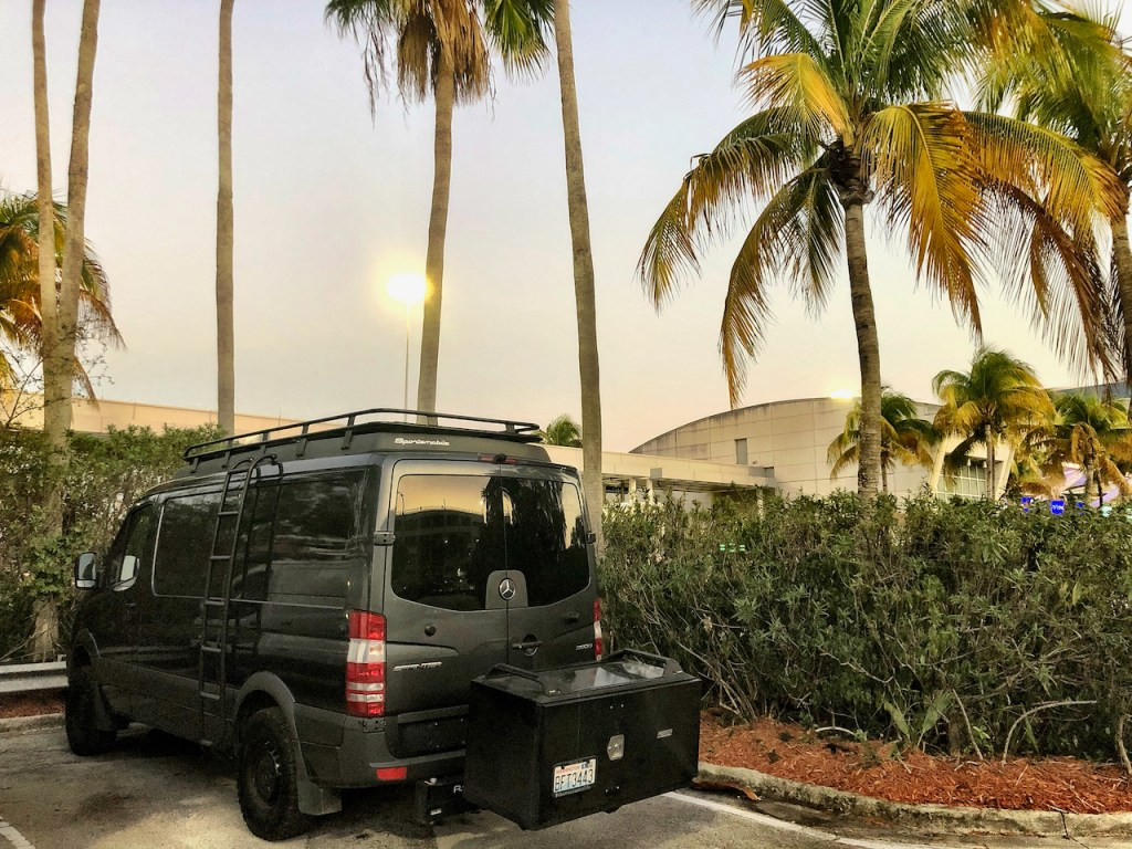 Our Sportsmobile Sprinter van hanging out at the Miami Airport oversized vehicle parking