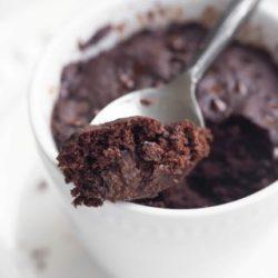 Spoon showing bite of vegan chocolate mug cake