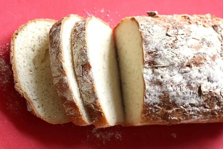 Overhead shot of Easy Gluten-Free Sandwich Bread loaf sliced