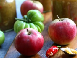 Apple and green Chilli Chutney with the apples and tomatoes displayed on a board