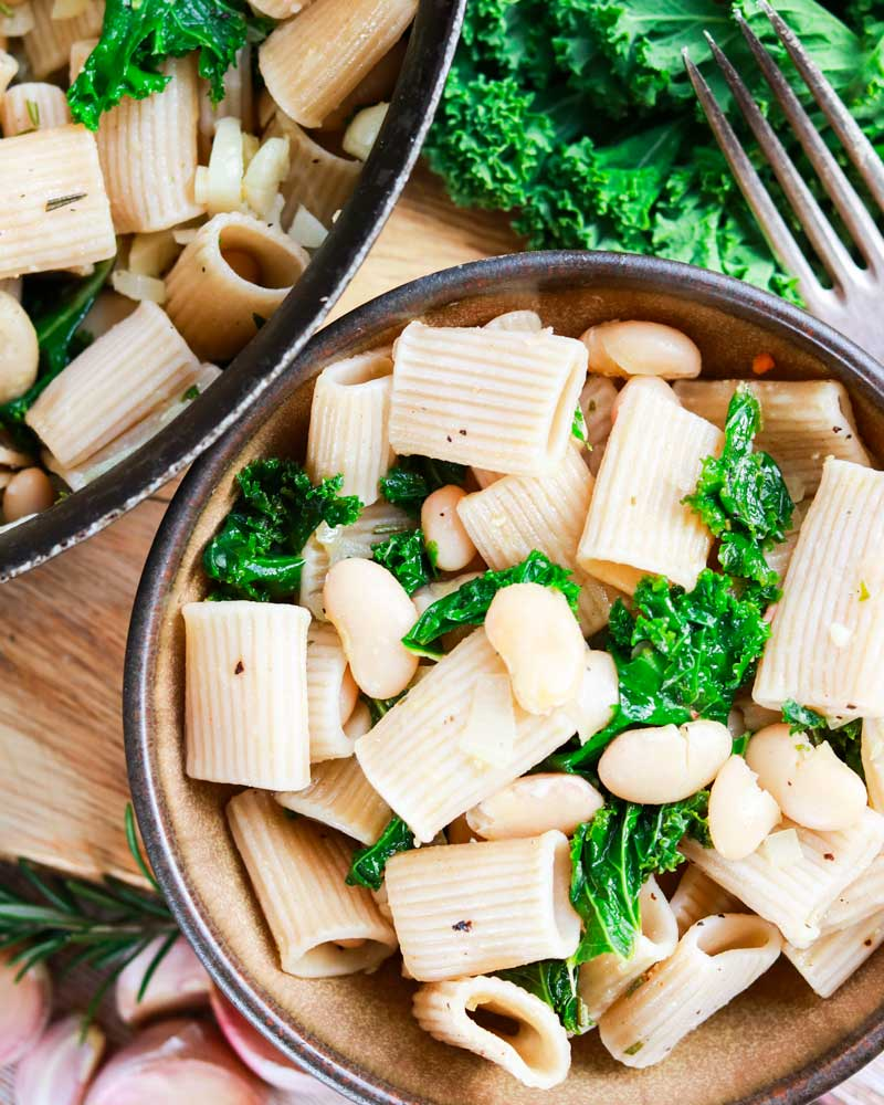 White beans and greens pasta in a bowl