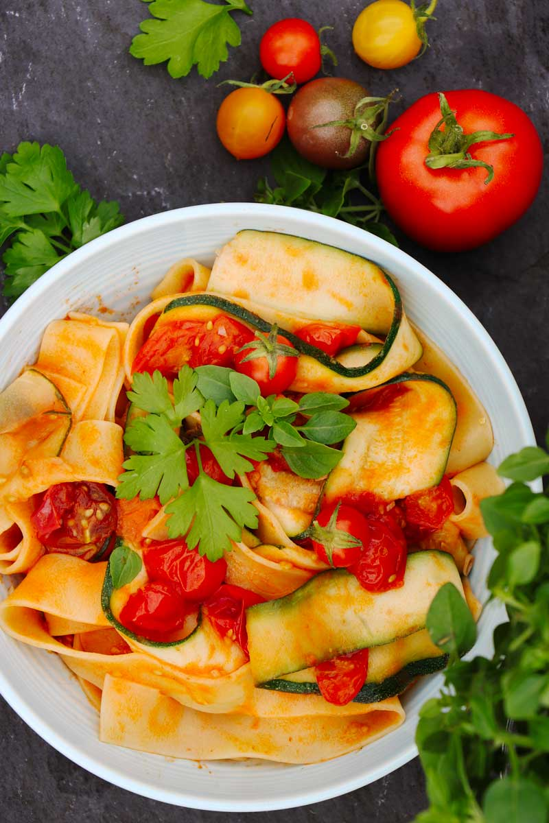 Courgette and Tomato Pasta in a bowl on a table