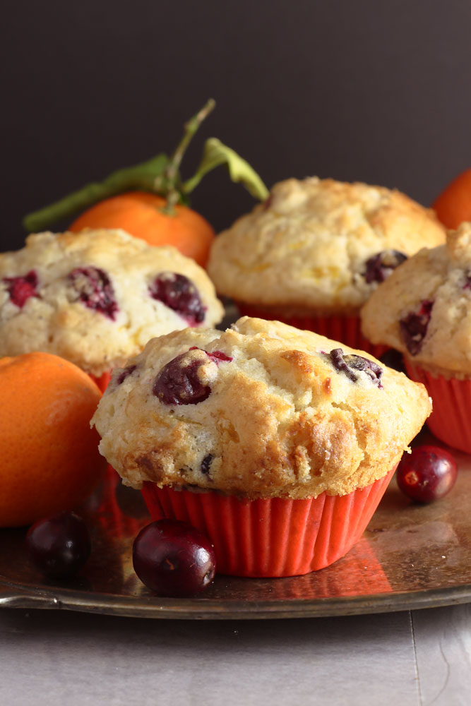 Vegan Fruity Muffins on a tray with clementines