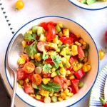 Char Grilled Corn salad with tomatoes, and herbs.