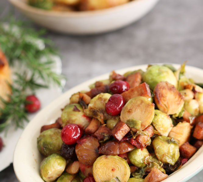 Cranberry, Chestnut and Tofu 'bacon' Brussel Sprouts with potatoes in backgrouns