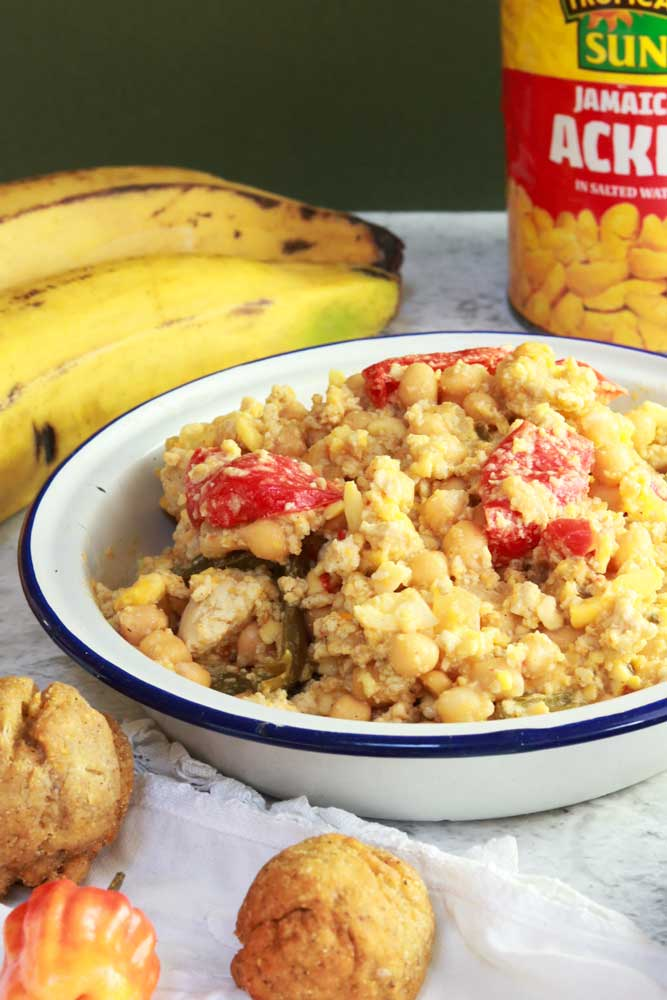 Ackee and Tofish close up with plantain and tin of ackee in the background