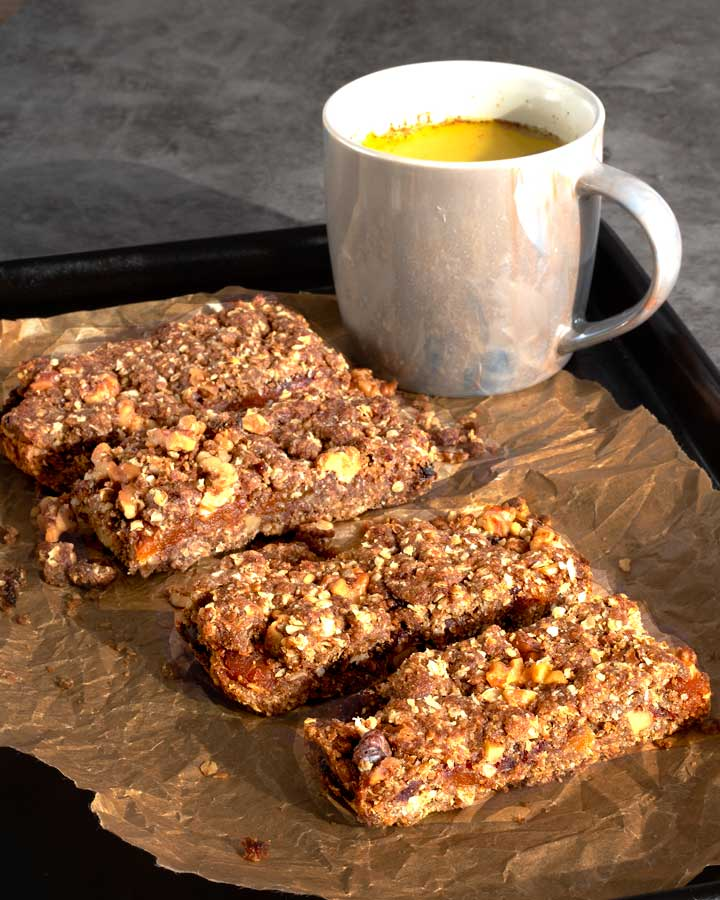 Apricot Date Bars with Turmeric latte in background