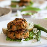Herb Infused Lentil Cakes on a plate with Asparagus, potatoes and wild garlic pesto