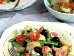 Vegan Salade Nicoise on a plate with lots of herbs