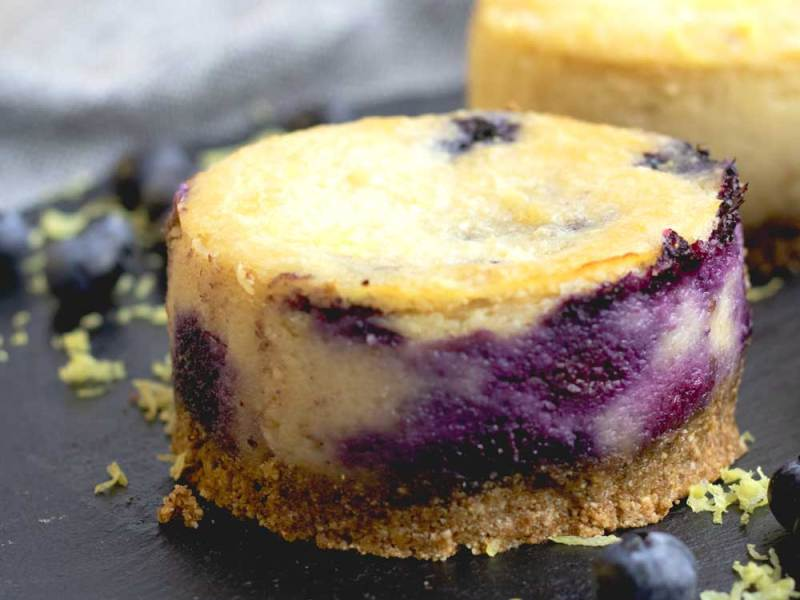 Lemon and Blueberry Vegan Cheesecakes up close on a plate