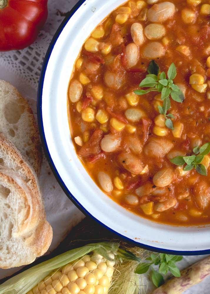 Borlotti, Corn and Tomato stew in a bowl close up
