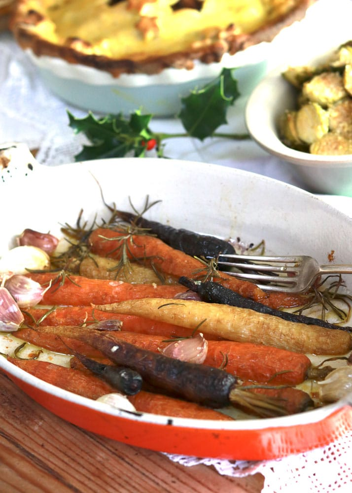 Christmas Carrots with thyme and garlic in a roasting dish on the Christmas Table