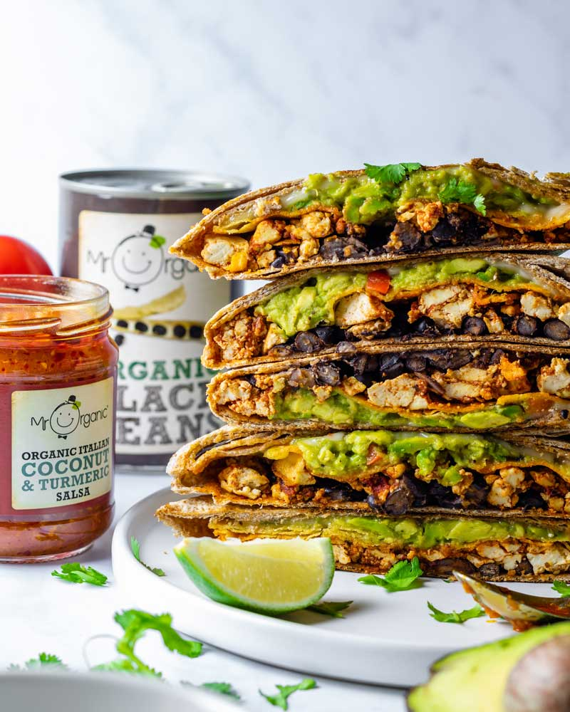 Huge Crunch Wraps stuffed with beans and avocado plus Mr Organic Salsa