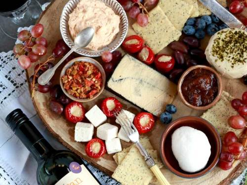 Cheese board with lots of vegan cheese on it