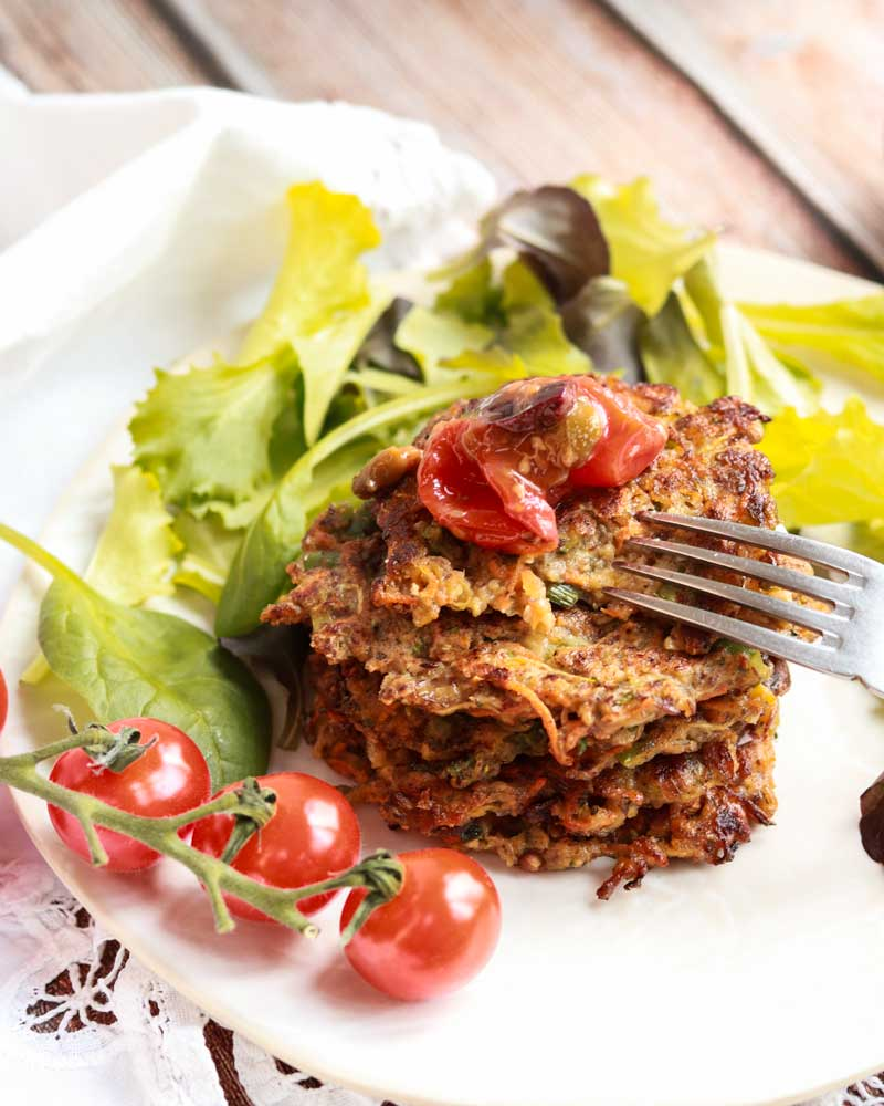 Vegetable fritters with tomato compote on top.