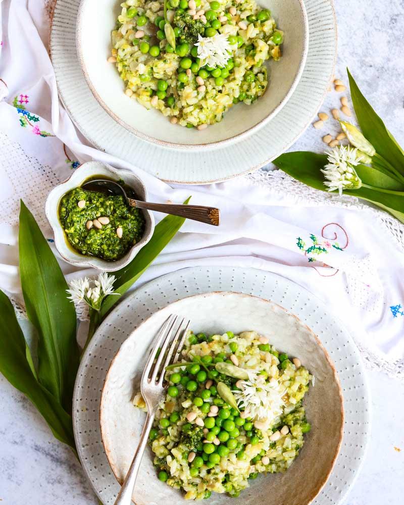 Wild Garlic Pesto & Pea Risotto on plates with extra pesto