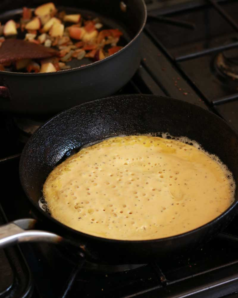 Vegan Omelette in the pan before flipping
