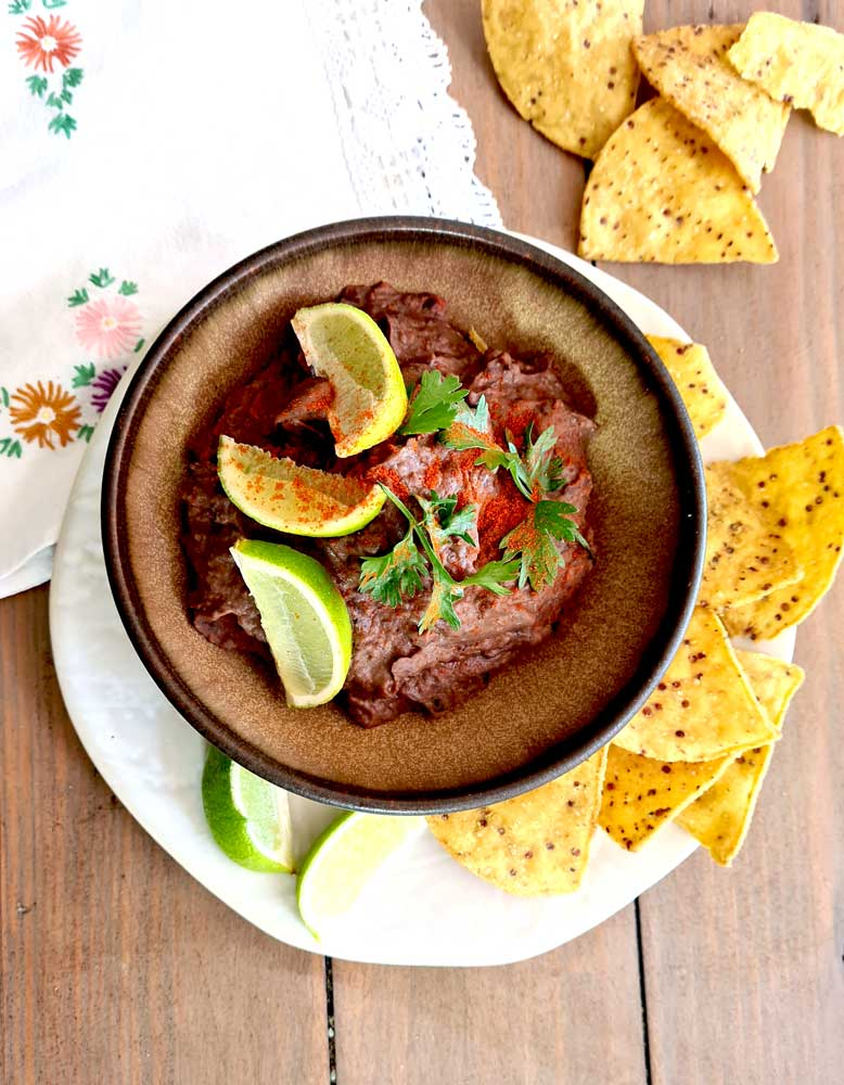 Chipotle Bean Dip with lime quarters on top