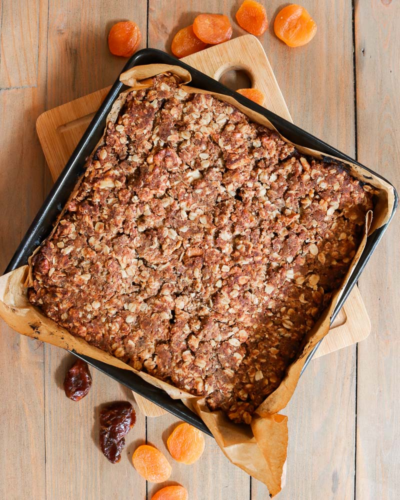 Apricot, date and walnut bars in a tin