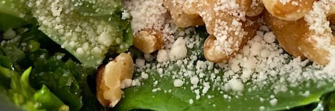 Banner of vegan pesto ingredients: walnuts, basil and vegan parmesan.
