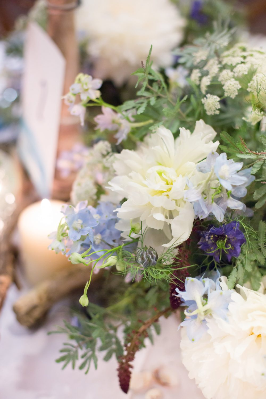 Happy bride holding bespoke colourful flowers