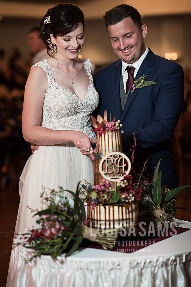 bride and groom; cut the cake; tiered cake;
