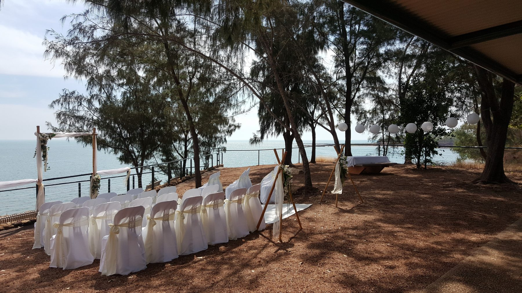 white wedding; here comes the bride; paper lanterns; cliff top views; outdoor ceremony; fannie bay
