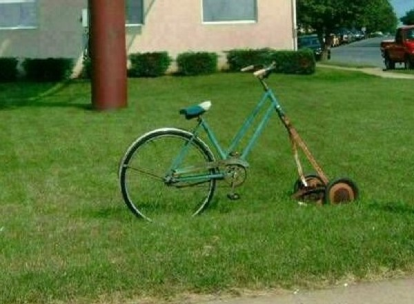 push lawn mower attached to the front of a bicycle