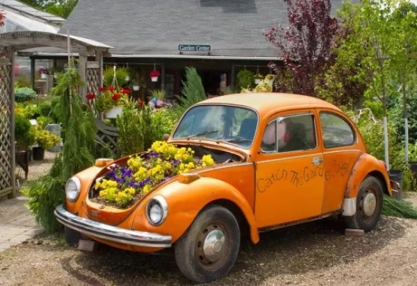 Orange Volkswagen Beetle Covered in Flowers