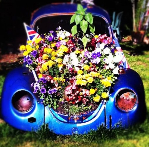 Blue Volkswagen Beetle Covered in Flowers