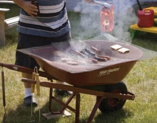 Wheelbarrow turned into a BBQ