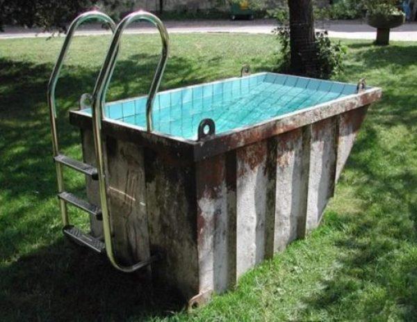 Refuse Skip made into swimming pool