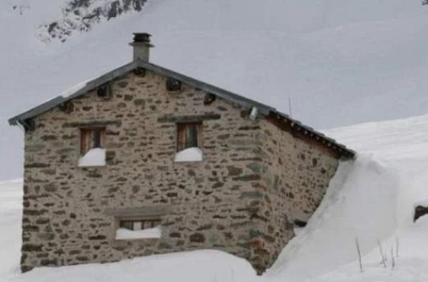 Snow on Building Looks Like a Face