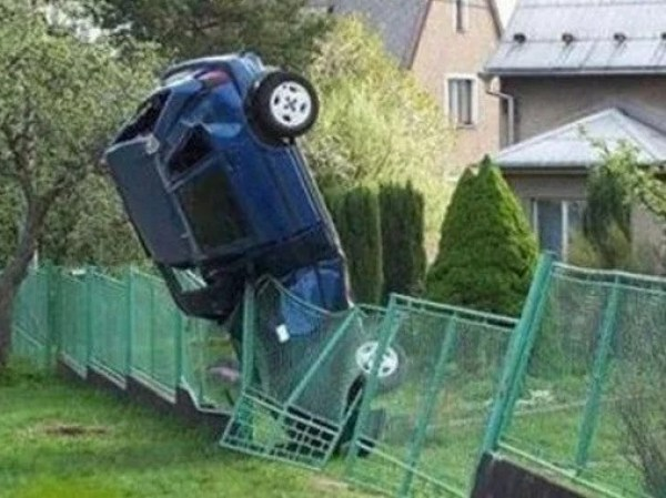Car crash onto fence