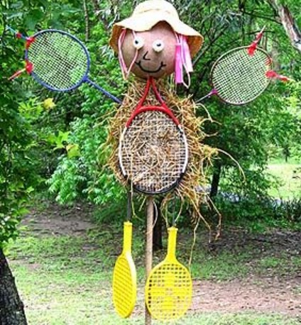 Sports Racket Transformed Into a Scarecrow