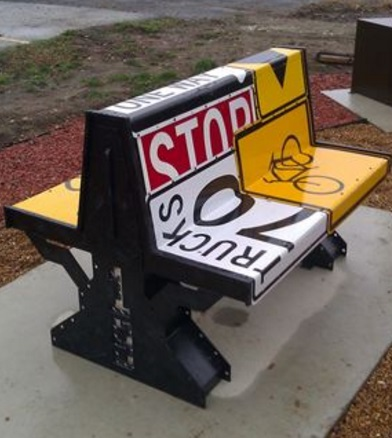 Street signs repurposed as a bench