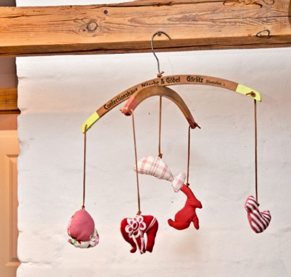 Old Clothes Hanger Used to Make a Babies Cot Mobile