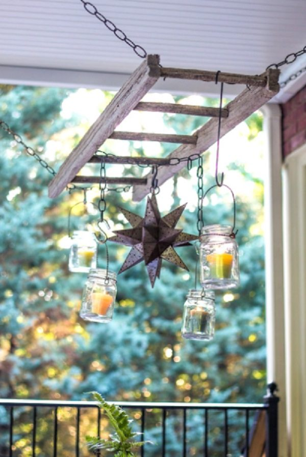 Old Wooden Ladder Used to Make a Patio Candle Hanger
