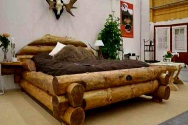 A Bed Made From Wooden Logs