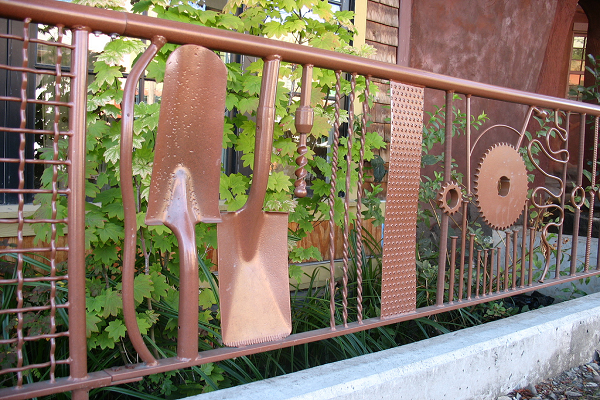 A Fence Made From Metal Parts