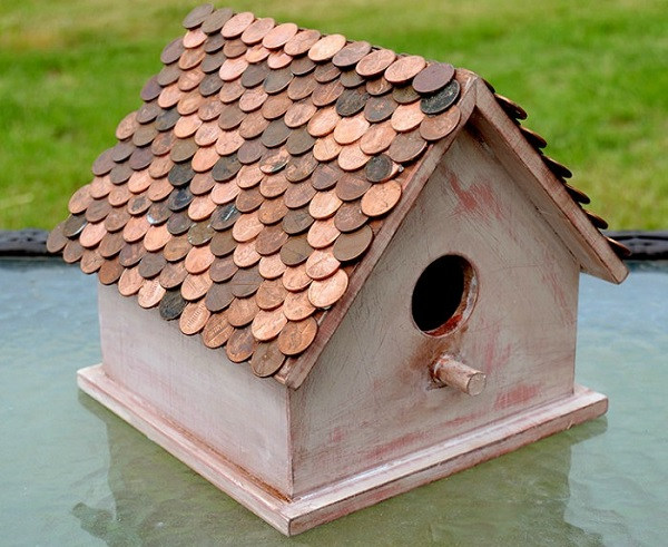 A Birdhouse Made From Coins