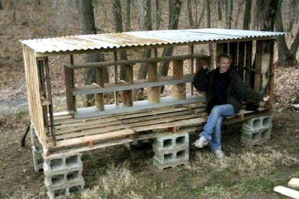 A Chicken Coop Made From Wooden Pallets