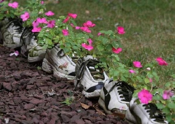 Garden Edging Made With Old Shoes and Trainers