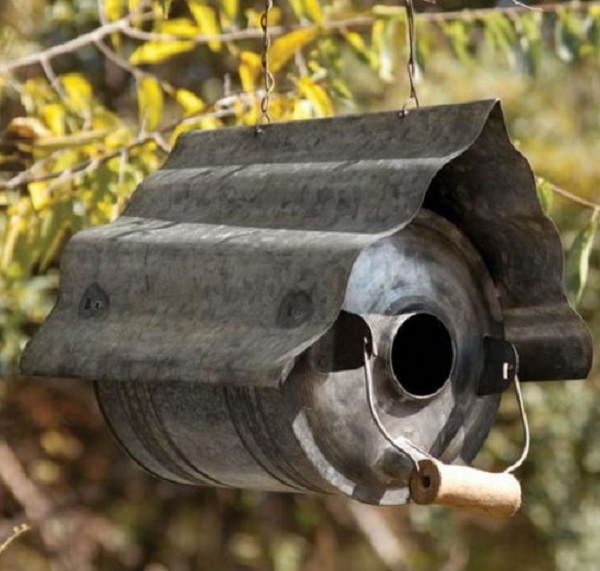 An Old Oil Can Used to Make a Birdhouse