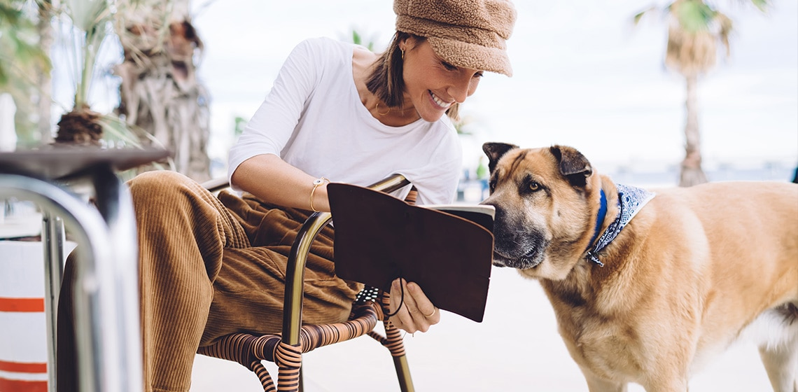 girl with her dog in cafe